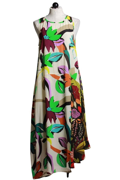 sleeveless tropical floral print dress by Alembika with a split wrap skirt in two different florals