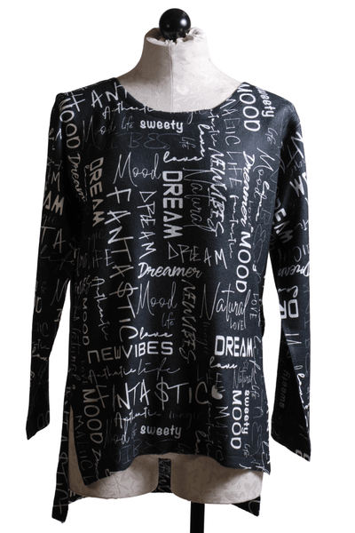 "boxy style top by Nally and Millie with a generous fit, straight cut high low hemline and side vents.  It features a boat neckline and graffiti style printed white words like ""mood, dream, life etc"""