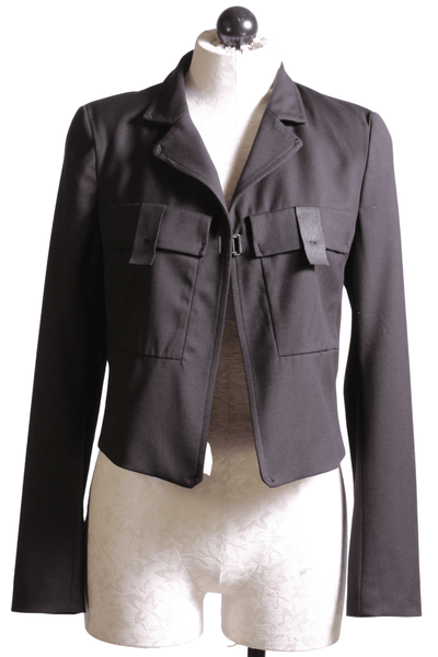 black cropped blazer by Beate Heymann with two front flap pockets with a single hook closure