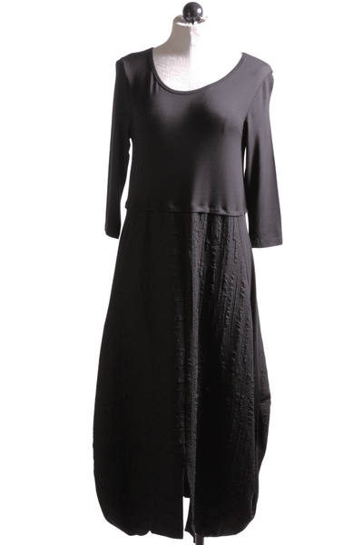 very comfortable 3/4 sleeve black knit dress with a Black puckered skirt