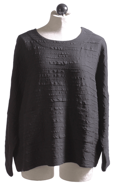 Loose fitting long sleeve black pucker fabric Sam top by Kozan with two front pockets