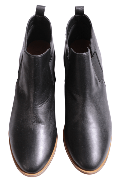 "slip-on black leather bootie by Charleston Shoe Company with elastic stretch sides and a 1 1/2"" wood stacked heel"