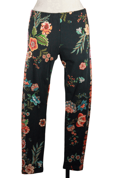 floral Printed knit Leggings by Johnny Was in a black background with colorful floral stripes down the sides too