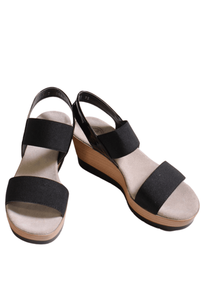 black platform wedge sandal by Charleston Shoe Company with a padded insole and elastic 2 strap slingback upper