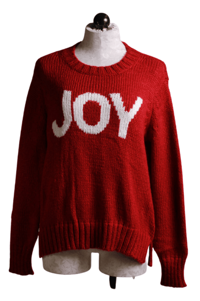 Red Crewneck Sweater with White JOY spelled across the front by Wooden Ships with a side slits.