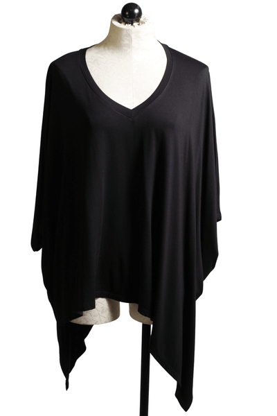 black V neck poncho style body with an asymmetrical hemline