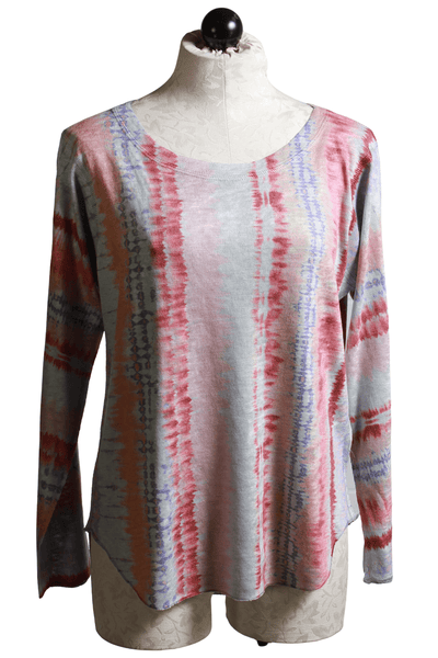 long sleeve vertical tie dye printed top in purple and terra cotta colors with a curved hemline