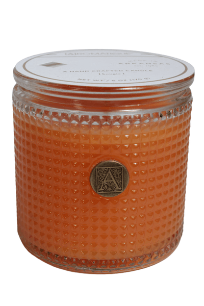 cylinder-shaped, textured glass candle in a Valencia Orange fragrance