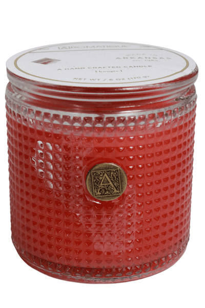 cylinder-shaped, textured glass candle in the Pomelo Pomegranate fragrance