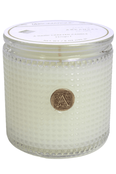 cylinder-shaped, textured glass candle in a White Teak & Moss fragrance