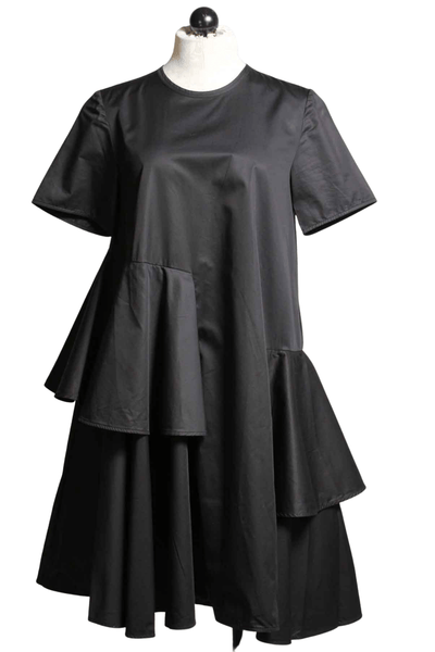 Short sleeve black dress by JNBY with a full ruffle that winds around the body
