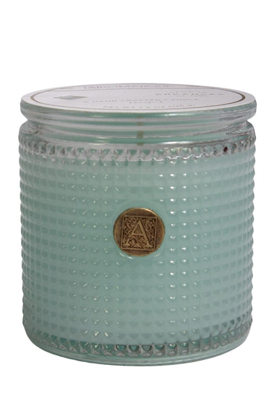 The Cotton Ginseng fragrance textured glass candle by Aromatique