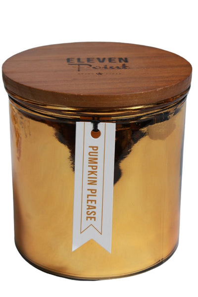 A Pumpkin Please candle in a large metallic peach colored vessel by Eleven Point