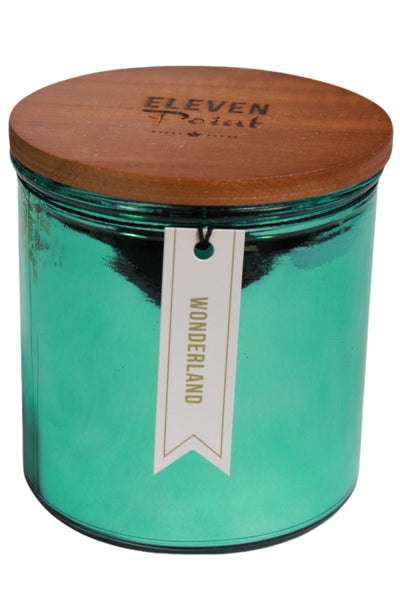 A Wonderland Fragranced Candle by Eleven Pint in a Metallic Green mercury glass vessel
