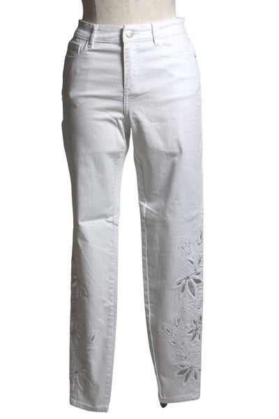 high waisted white denim jean by Frank Lyman with cut out leaf patterns and embellishment on the front sides of the pant legs