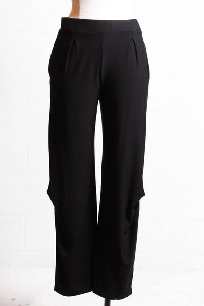 Black pull on pocketed knit pant by Chiara Cocol with pinched detail at the knees