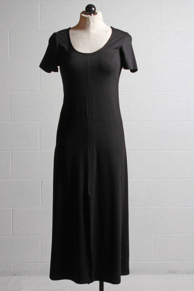 Short sleeve scoop neck black midi length knit dress by Fifteen Twenty with a front slit