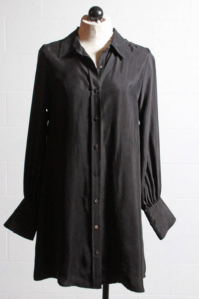Black, shiny long sleeved, collared, shell button up dress with cuffed, button up sleeves