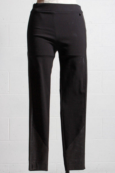 Pull on skinny black pant by Que with a faux leather stripe down the side and angled around the bottom