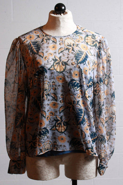 blue long sleeve semi sheer floral printed short top by Roller Rabbit with cami underneath