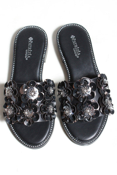 black patent slides by Spring Footwear with 3D flowers covering top of the shoe