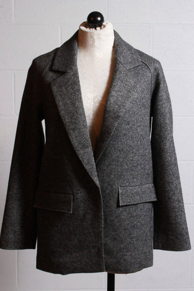 Loose fitting gray flannel looking blazer by The Korner with seams down the back.