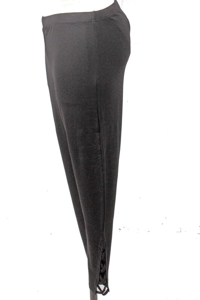 side view of Black leggings by Tricotto with lattice cut out detail on each sides of the bottom ankles