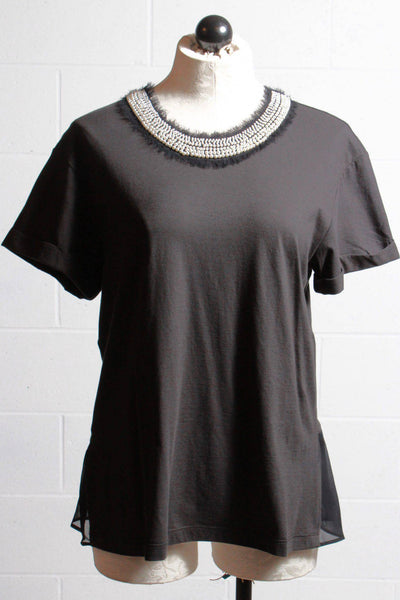 pearl neckline black tee by Twinset with a ruffle bottom bac