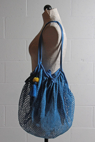Blue Cotton String foldable shopper bag with hanging pom pom tassel