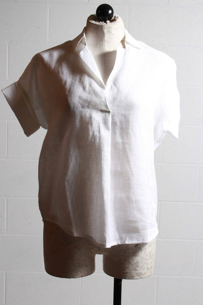 Cuffed capsleeve white shirt by Vilagallo with covered button placket.