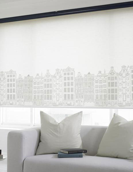 Elite shades custom printed with a hand-drawn cityscape across the bottom and installed on a living room window