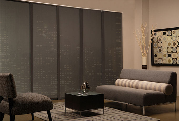 Elite panel shades installed on the windows of a high rise condo blocking out the bright city lights