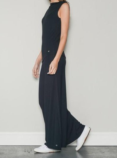 black sleeveless relaxed neck top and palazzo trousers