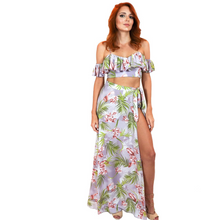 Load image into Gallery viewer, Lavender and floral off-the-shoulder cropped top and tie-wrap skirt with a high-side leg slit, made in polyester.