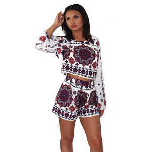 Long sleeve white, purple and burgundy printed top and high-waisted short set, made in rayon.