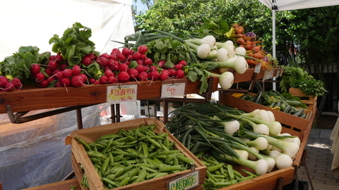 farmer's market with radishes and green onions