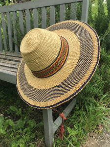 Handwoven straw hat from Ghana, natural grass, red and yellow and black pattern