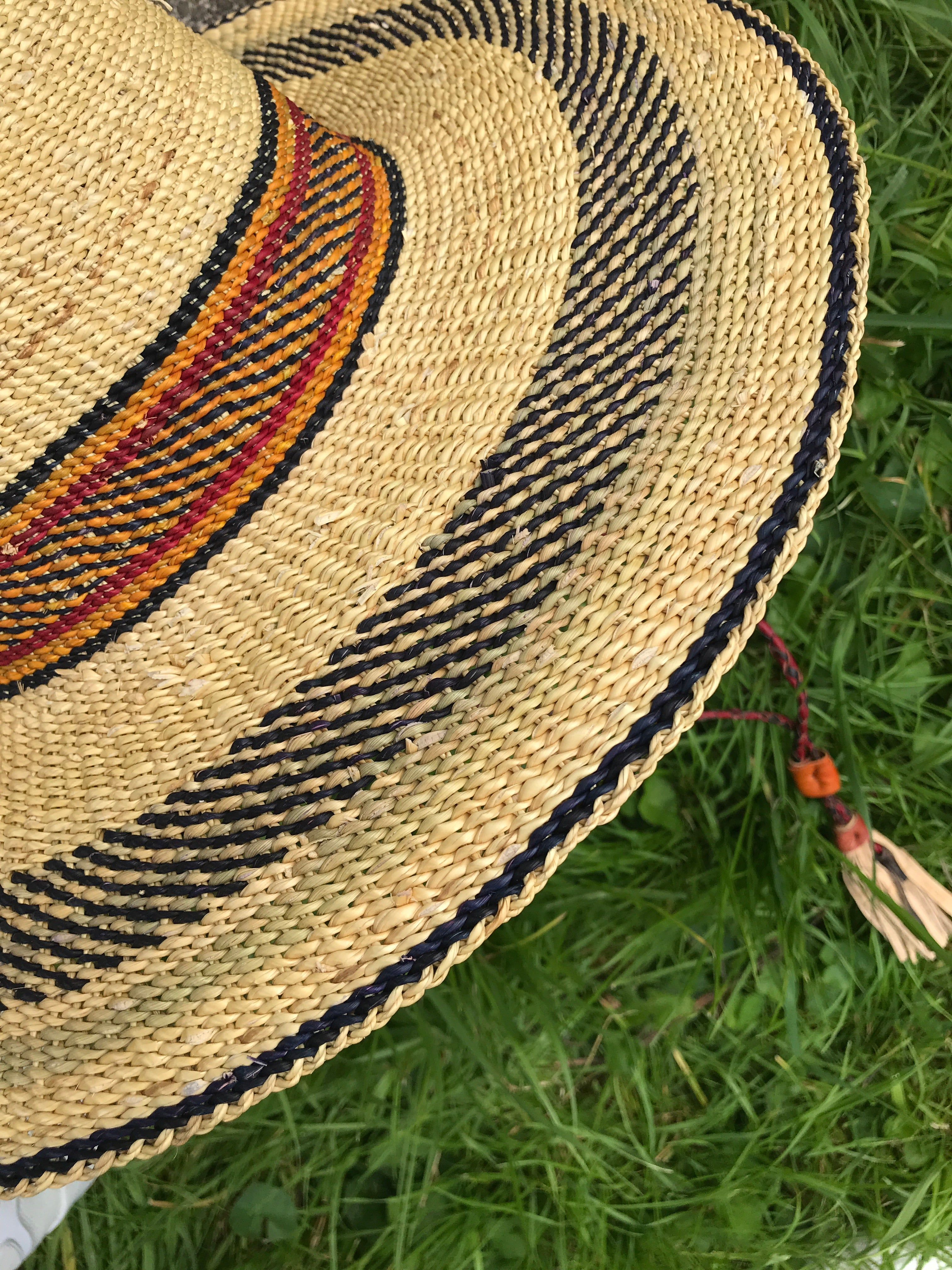 Handwoven straw hat from Ghana, navy blue and yellow pattern