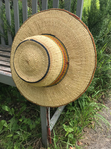 Handwoven straw hat from Ghana, yellow, red and black striped