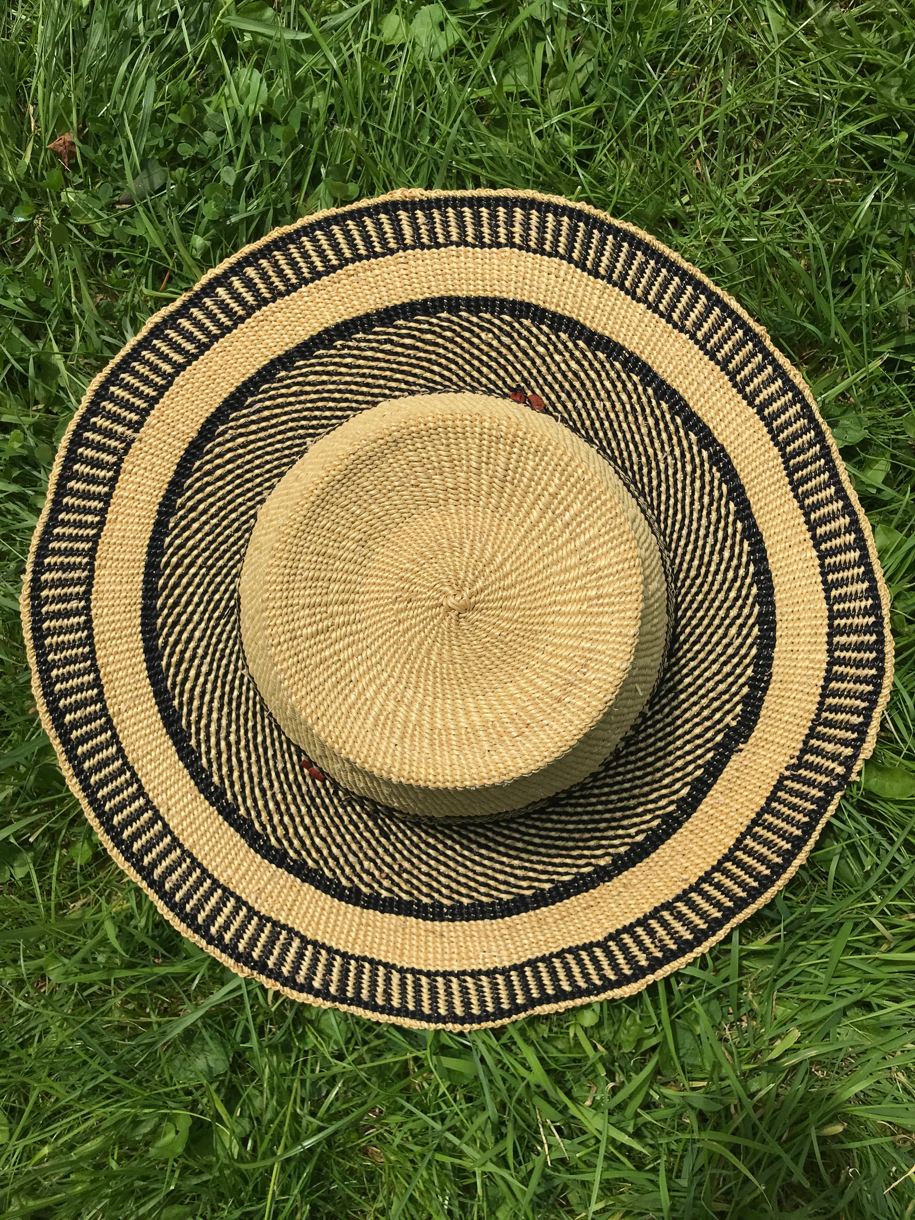 Handwoven straw hat from Ghana, natural grass and navy pattern