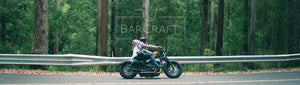 Man Riding Custom Harley Davidson Sportster Motorcycle