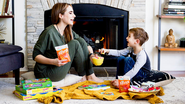 mother and child enjoying family game night with yumearth organic candy