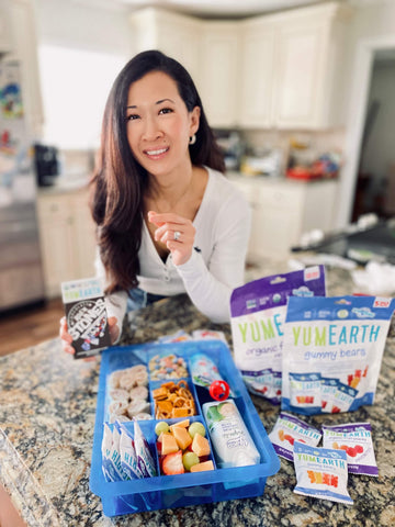 linh with yumearth roll'n stones, fruit snacks, and lunch snack board