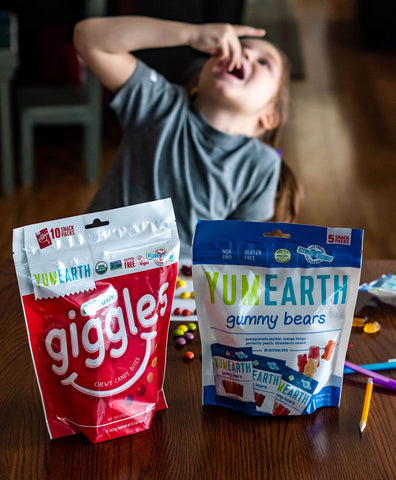 child enjoying organic candy with giggles and gummy bears