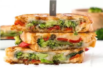 Grilled cheese sandwich with roasted broccoli and red peppers
