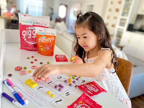 child using yumearth giggles and chewys for home learning