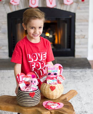 child with yumearth valentines day candy basket