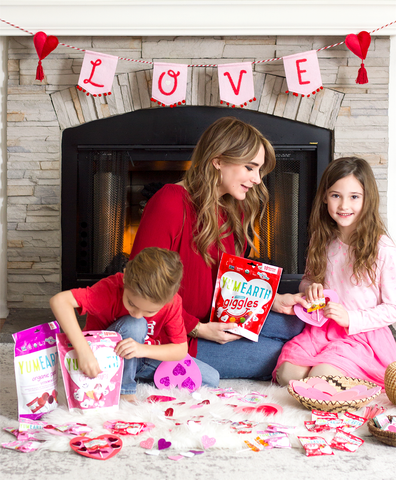 mom with children enjoying yumearth valentines day candy