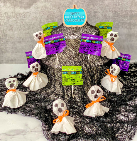 Coffee filter ghosts made with YumEarth Halloween lollipops