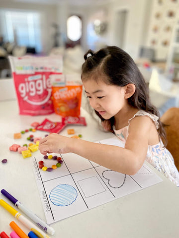 child using organic giggles to create shapes